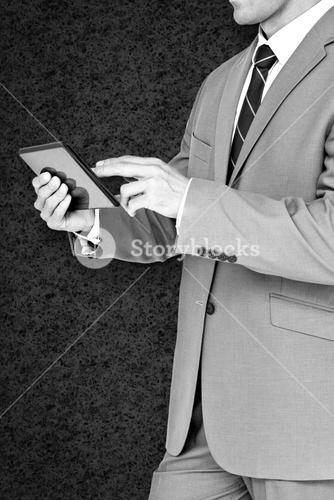 Composite image of businessman using tablet pc