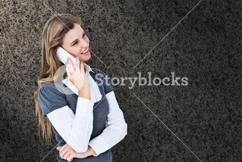Composite image of happy blonde on the phone
