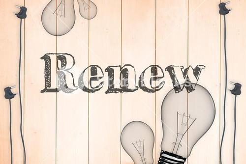 Renew against light bulb on wooden background