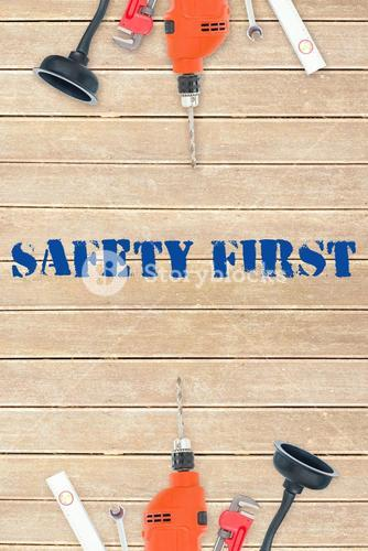 Safety first against tools on wooden background