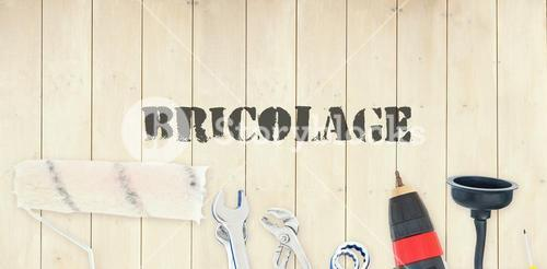 Bricolage against diy tools on wooden background