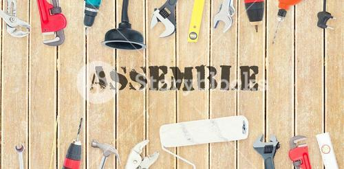 Assemble against diy tools on wooden background
