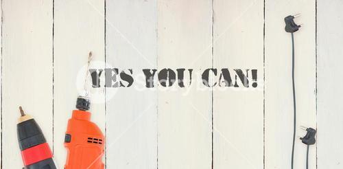Yes you can! against diy tools on wooden background