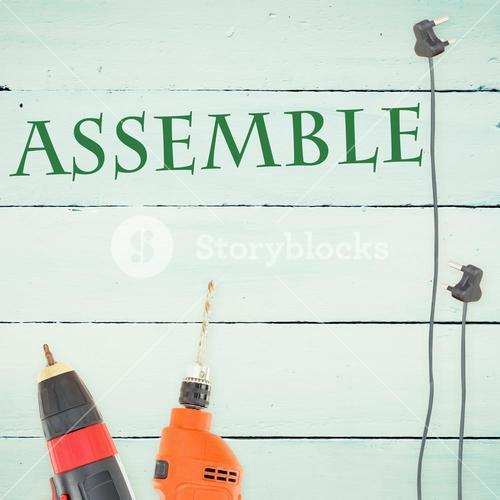 Assemble against tools on wooden background