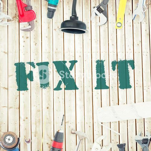 Fix it against tools on wooden background