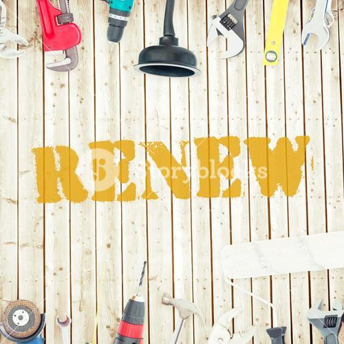 Renew against tools on wooden background