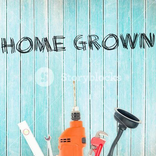 Home grown against tools on wooden background