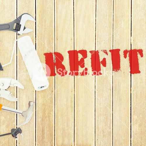 Refit against tools on wooden background