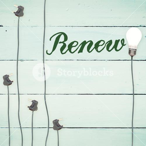 Renew against light bulbs on wooden background