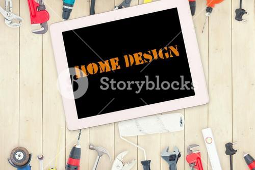 Home design against tools and tablet on wooden background