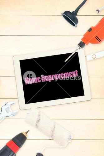 Home improvement against tools and tablet on wooden background
