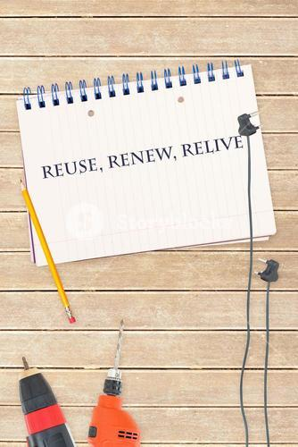 Reuse, renew, relive against tools and notepad on wooden background