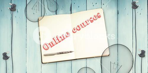 Online courses against notepad and bulbs on wooden background