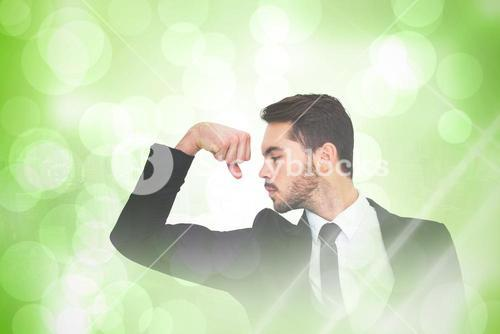 Composite image of cheerful businessman tensing arm muscle