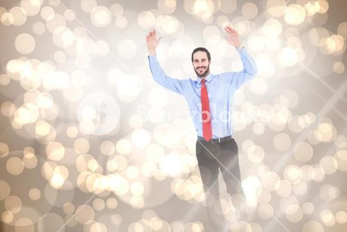 Composite image of smiling businessman stepping with hands raised