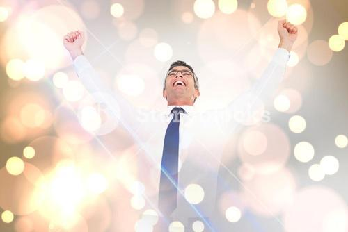 Composite image of excited businessman with glasses cheering