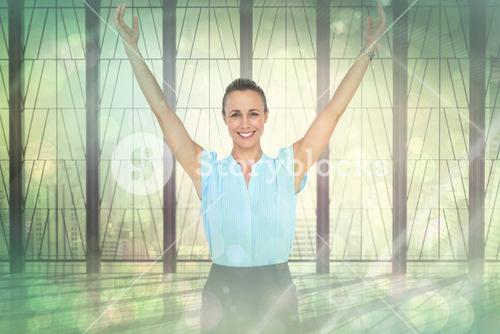 Composite image of businesswoman with arms raised