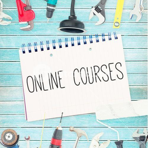 Online courses against tools and notepad on wooden background