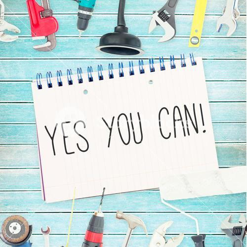 Yes you can! against tools and notepad on wooden background
