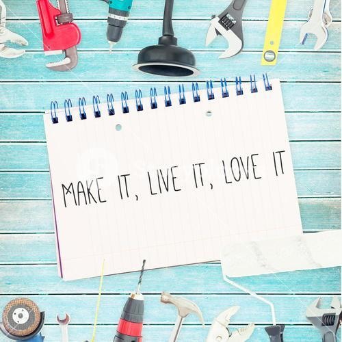 Make it, live it, love it against tools and notepad on wooden background