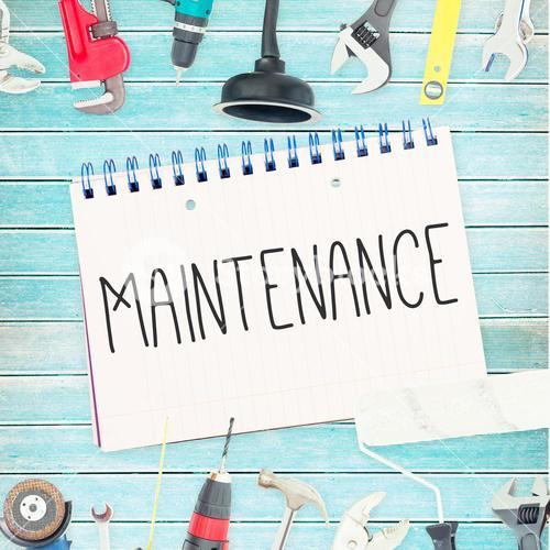 Maintenance  against tools and notepad on wooden background