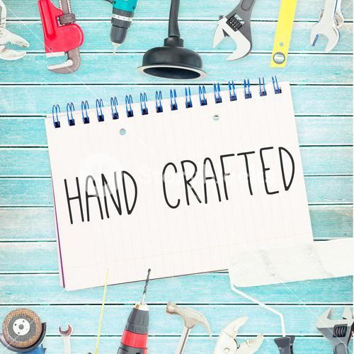 Hand crafted against tools and notepad on wooden background