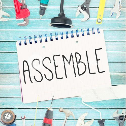 Assemble against tools and notepad on wooden background