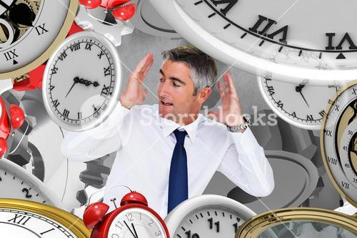 Composite image of businessman looking up with arms up