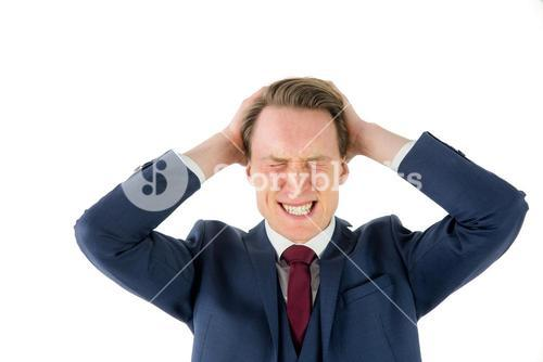 Nervous businessman looking at camera with hand on head
