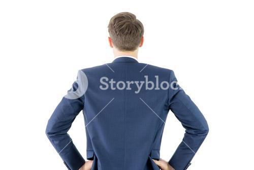 Wear view of businessman with hands on hip