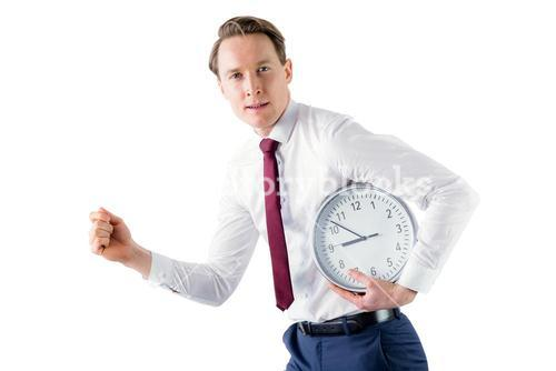 A businessman running with clock