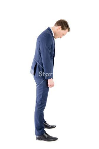 Defeated businessman looking at his shoes