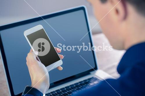Rear view of businessman using smartphone