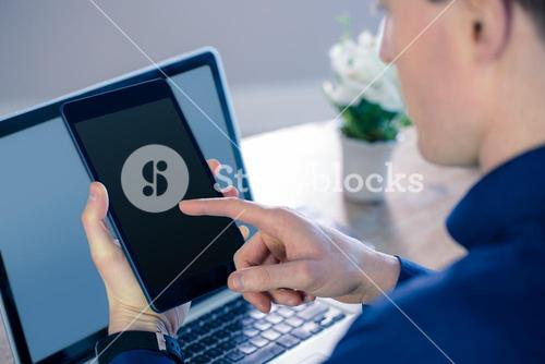 Rear view of businessman using tablet