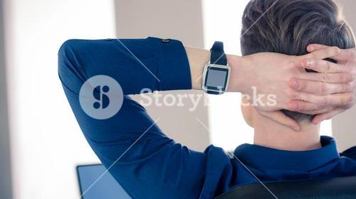 Rear view of businessman wearing smartwatch