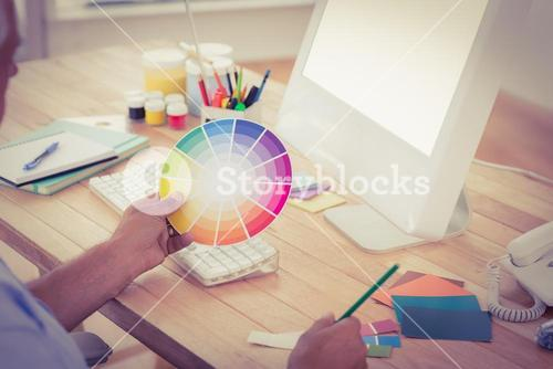 Businessman working with colour watch