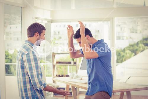 Excited businessmen clapping their hands