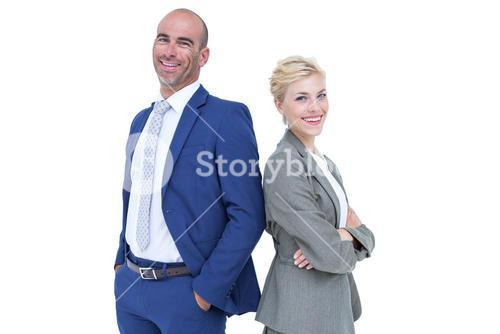 Smiling business people back-to-back