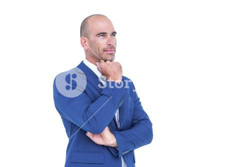 Businessman thinking with hand on chin