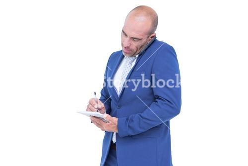 Young businessman writing on a notepad