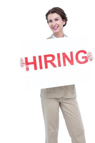 Businesswoman holding a hiring sign