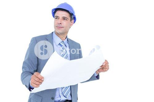 Businessman looking at a blueprint
