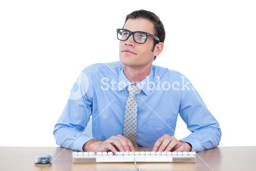 Concentrated businessman typing on the keyboard