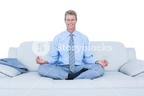 businessman meditating in yoga pose