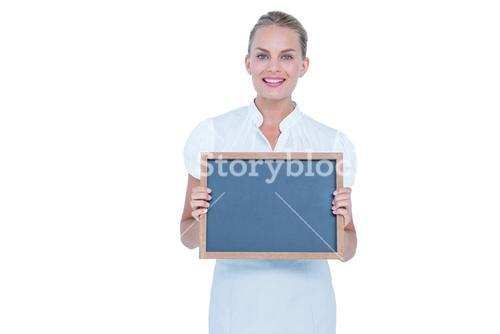 businesswoman holding a black board