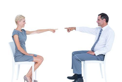 business people pointing at each other