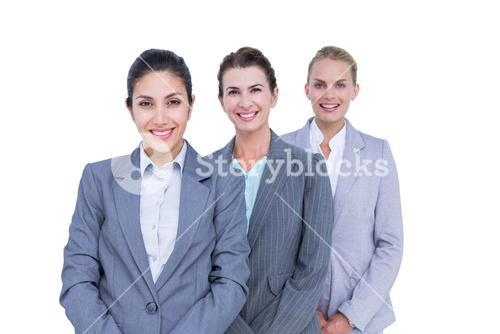 Smiling young businesswomen in a line