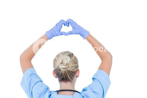 blond female doctor doing an heath sign