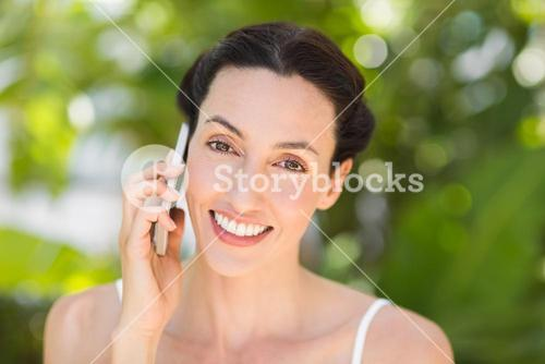 woman in white using her phone