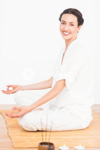 A woman in a meditation position